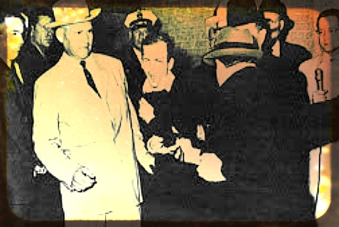 The iconic moment when Jack Ruby - whose birth name was Jacob Leon Rubenstein - shot Lee Harvey Oswald.