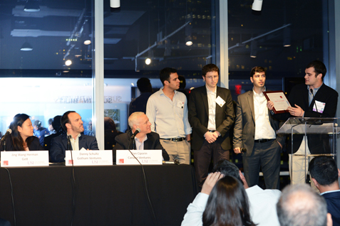 (R-L) At 7 World Trade Center, Paul Grossinger and David Bratslavsky, executive director of USI; present the Israel to NYC People's Choice Award to Saar Yoskovitz and Gal Shaul, the co-founders of Augury Systems. Panel judges Dan Ciporin, Canaan Ventures; Daniel J. Schultz, Gotham Ventures; and Jing Wang Herman, GetTaxi USA, look on.