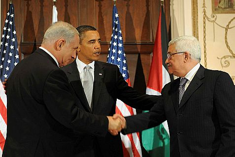 Netanyahu shakes hands with Abbas in 2009 in a meeting arranged by Obama, for whom they share mutual suspicion.