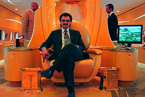Billionaire Saudi prince Alwaleed bin Talal on his airplane throne, sitting under the logo of his company. Alwaleed has no confidence in Obama when it comes to Iran.