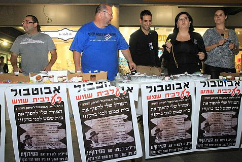 Beit Shemesh residents demonstrate outside the Beit Shemesh municipality as mayor Moshe Abutbul holds a council meeting .