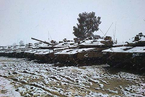 IDF tanks in the snow. Hezbollah is not ready to open a second front with a better prepared Israel, especially in light of the Terrorist organization's involvement in Syria.