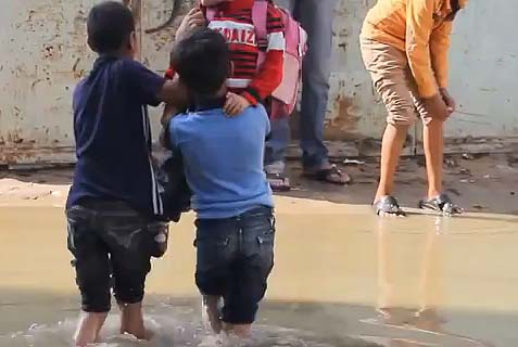 Children Wade in Gaza Raw Sewage