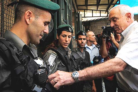 Minister of Internal Security Yitzhak Aharonovitch reviewing border police on a tour of Jerusalem's Muslim Quarter of  Old City. The Jews of Judea and Samaria are complaining that under Aharonovitch's leadership, police are targeting them as the enemy.