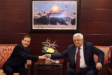 Newly elected leader of the Israeli Labor party Isaac Herzog meets with Palestinian President Mahmoud Abbas in Ramallah.