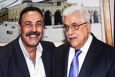 "Fatah legislator and activist Jamal Abu al Rub (left), affectionately known to his colleagues as ""Hitler,"" with PA President Mahmoud Abbas."