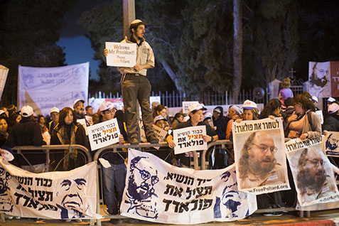 "Israeli protesters holding placards reading ""Free Pollard"" and portraits of Jonathan Pollard during a protest calling for Pollard's release from U.S. prison outside Israeli President Shimon Peres's Jerusalem residence earlier this year."