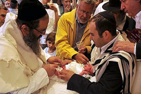 Are you a new father read to help circumcise your  son? Above: Brit Milah in Paris.