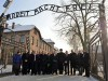 Knesset members walk through the entrance of Auschwitz. (archive)