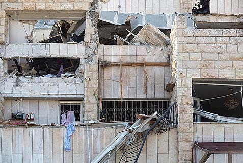 The top floor of a building collapsed after a gas tank exploded in the Gilo neighborhood of Jerusalem, January 21, 2014. Three people were killed in the explosion.