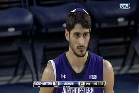 Northwestern University basketball player Aaron Liberman in his blue and white unifrom and matching kippa.