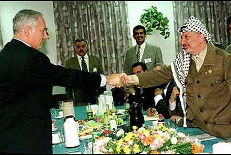 Netanyahu shaking hands with Arafat in Hebron.