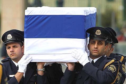 The Knesset Guard carrying the coffin of former Israeli Prime Minister Ariel Sharon, while thousands came to pay their last respects. It appears that other than his immediate family, all of Israel, as well as in many of its neighbors, people are having mixed and often harsh memories of the old general.