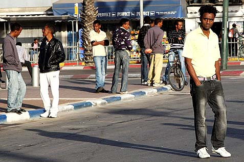 Sudanese and Eritrean illegal migrants hanging on the streets of South Tel Aviv, looking for day work. Murder rates among the illegal migrants are 9 times higher than in the population at large in Israel.
