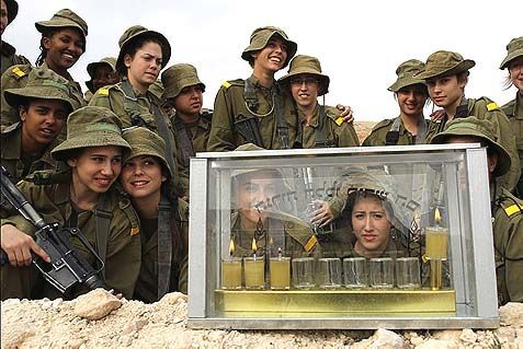 Israeli female Border Police soldiers lighting Chanukah candles. There is no reason why religious women not consider military service, although they might do better to avoid combat roles in mixed units.