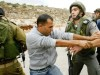 A Palestinian Authority man scuffles with a surprised Israeli soldier near Road 443, in 2007.