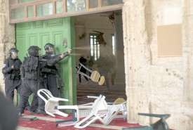 Arab rioters hurl objects at Israeli security personnel who use pepper spray to quell the violence emanating from the Al Aqsa mosque on the Temple Mount.