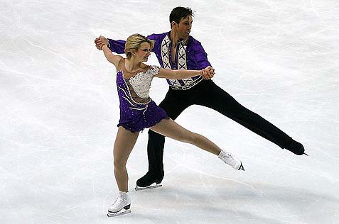 Dylan Moscovitch (seen with Kirsten Moore-Towers in 2011) has won a silver medal for the Canadian national team.