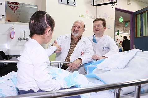 """K"" with two of Rambam's senior neurosurgeons, Dr. Joseph Juilburd (left) and Dr. Sergey Abeshaus (right)."