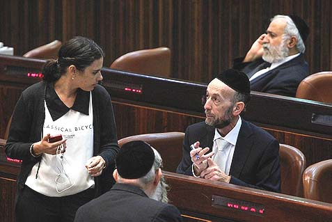 Jewish Home MK Ayelet Shaked arguing with United Torah Judaism MK Uri Maklev. Shaked is chair of the Knesset committee which this week will bring a final draft of the IDF enlistment law to a second and third vote, making it law.