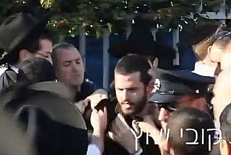 Police and Haredim scuffle on main road near Bnei Brak.