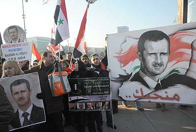 Syrians demonstrating in Geneva in favor of President Assad.