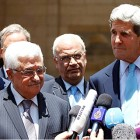 Acting Leader of the Palestinian Authority, Mahmoud Abbas (front left) and U.S. Secretary of State John Kerry (R) in Ramallah, June, 2013