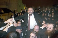 Shas candidate celebrates his victory in Beit Shemesh in the do-over elections.