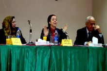 Nehad Abouel Komsan (center), of the Egyptian Center for Women's Rights, speaking at a 2012 panel