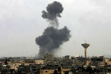 Smoke rises following an Israeli air strike on smuggling tunnels in Rafiah in the southern Gaza  on Thursday.