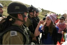 left wing protester shouts at Israeli soldiers, March 7, 2014.