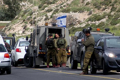 Israeli soldiers closed off the area near where a terror attack occurred  near Hevron on Passover eve, in search of the terrorists.