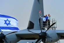 Israel's Defense Minister Moshe Ya'alon inspects the IAF's newest recruit, the Samson Super Hercules.