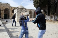 "Masked Palestinian Authority Arabs hurl blocks at Israel Police during and after ""worship"" at Temple Mount mosque. (archive photo)"
