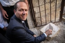 Jerusalem Mayor Nir Barkat puts cement on the official cornerstone celebrating the reopening of the Tiferet Israel Synagogue in Jerusalem's Old City.