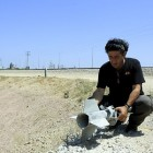 A man holds a rocket that exploded near the Gaza border. (file)