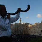 An Orthodox Jewish man blows the shofar near the Western Wall in Jerusalem, Israel's Old City.