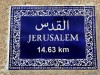 A sign announces the distance from the holy city of Jerusalem to the grave of the late PLO chairman Yasser Arafat at the Muqata in the Palestinian Authority capital of Ramallah.