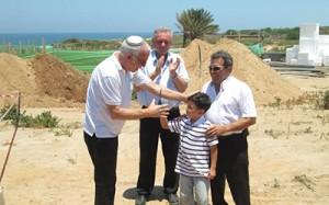 Minister Uri Ariel visiting the community