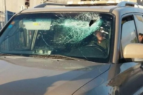 Windshield smashed by rock-throwers. (July 2015)