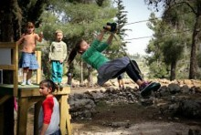 Children play at the Oz VeGaon park built in memory of three young Jewish boys who were abducted and murdered by Arab terrorists.