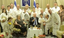 Israeli beekeepers, dressed in their white protective uniforms, are hosted by President Reuven Rivlin and First Lady Nechama Rivlin in the President's Residence in Jerusalem, August 30.