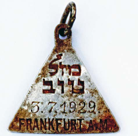 "A pendant with the Hebrew words ""Mazal Tov"" and the date July 3, 1929"