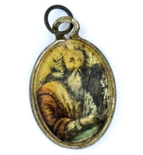 "A metal locket covered with glass with the image of Moses holding the Ten Commandments painted on it (engraved on the reverse side is the essential Jewish prayer ""Shema"")"