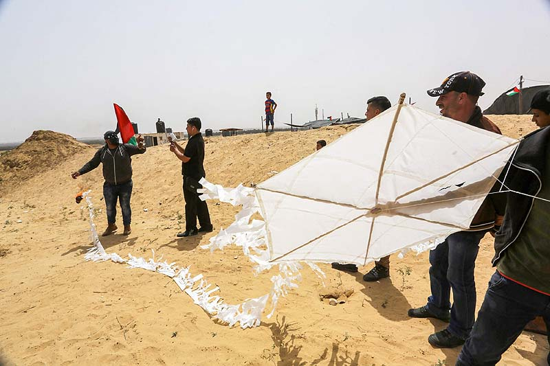 A team of Arab terrorists in Khan Yunis preparing to launch a kite with a Molotov cocktail attached to its tail