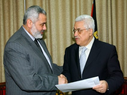 After two decades, Hamas has finally woken up to the power of lies. Like the PLO, Hamas has learned that in this instance, words are more important than actions. Pictured: Palestinian Authority President Mahmoud Abbas (right) shakes hands with Hamas's leader in Gaza, Ismail Haniyeh, during negotiations in 2007 for a short-lived unity government.