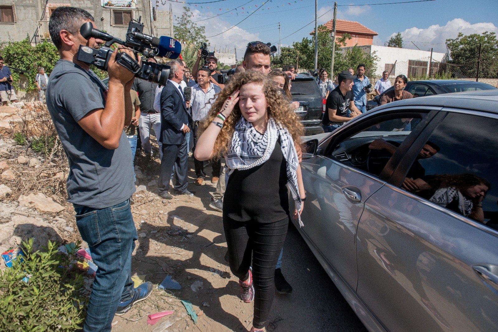 Abbas praises soldier-slapper Ahed Tamimi amid celebrations after release
