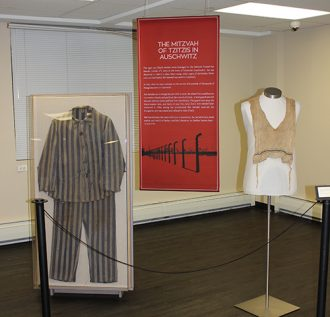 The uniform and the tzitzis on display at Amud Aish.