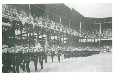 Ceremonial drills such as this one, prior to a Dodgers game at Ebbets Field, took place at many ballparks around the country in 1942