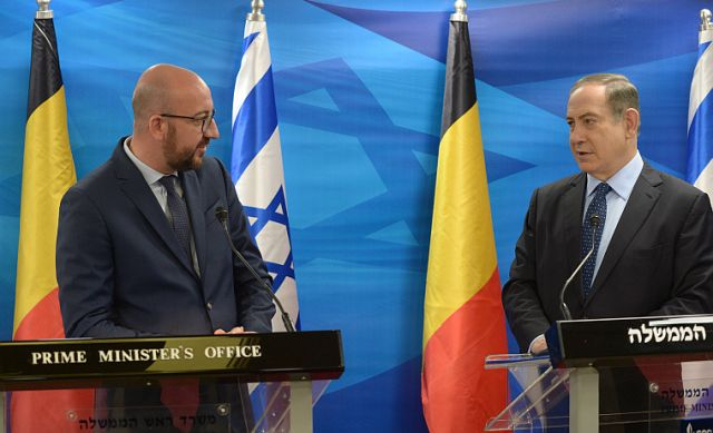 Belgian prime minister resigns over migration pact
